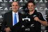 Peter Hancock, chief executive of AIG Property Casualty, and Richie McCaw, captain of the All Blacks, with new AIG All Blacks jersey.