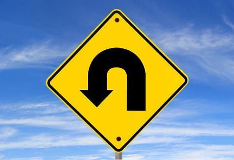 U-turn road sign