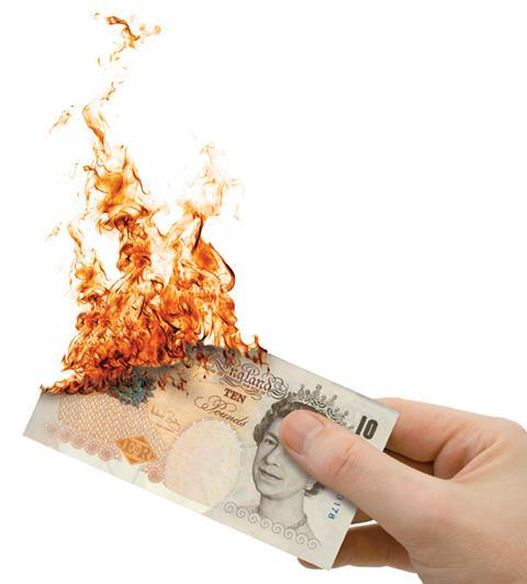 Money cash fire hand