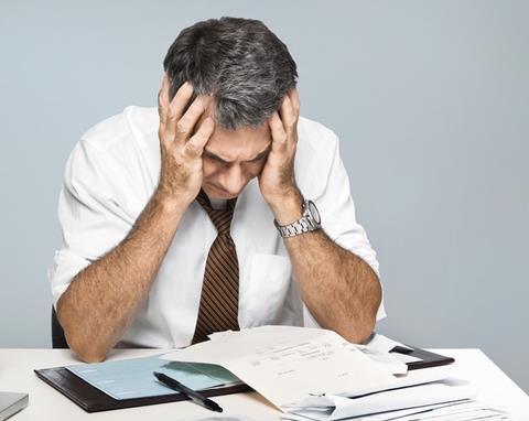Stressed distraught worried businessman