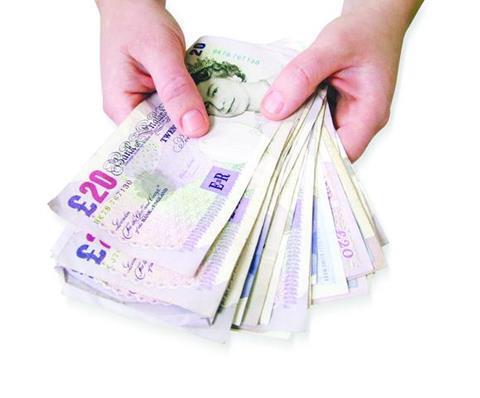 bigstockphoto Woman Holding Money 2658489
