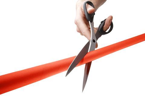 red ribbon cutting