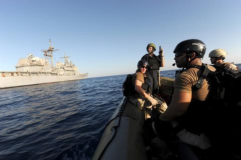 Gulf of Aden: Members of the visit, board, search and seizure team of the guided-missile cruiser USS San Jacinto (CG 56) wait for instructions to resume counter piracy operations.