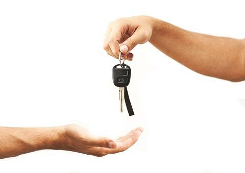 Hands giving motor car keys