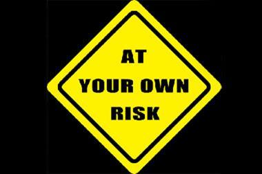 at your own risk sign