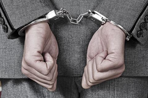Businessman jail handcuffs fraud